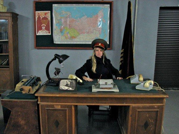 Russian travel agent with Captain's hat
