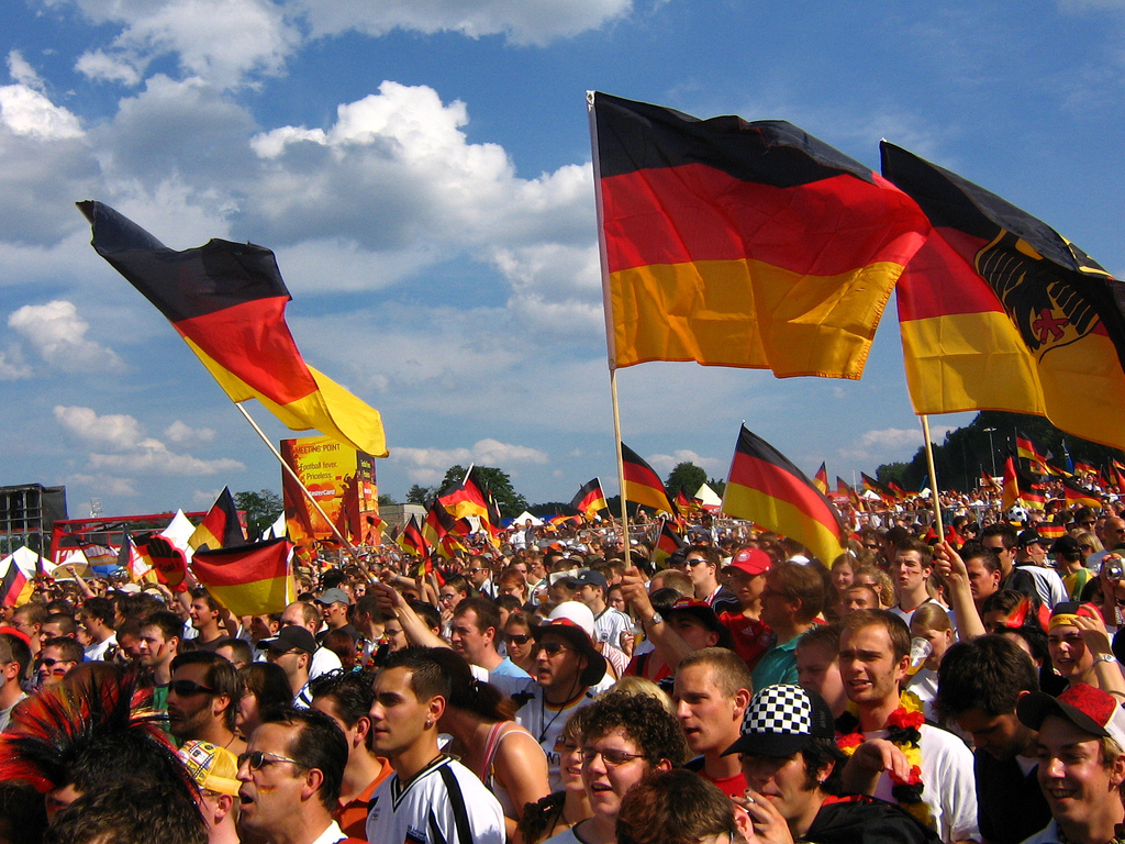 German fans at a sports match with flags