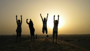 UAE travellers jumping on a beach