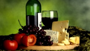 Wine and cheese platter with grapes