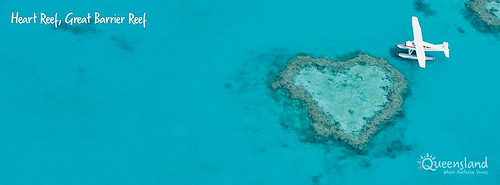 Blue seas with a heart shaped reef in the water
