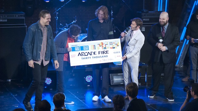 Winners accepting award at music festival