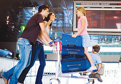 Family with suitcases in airport