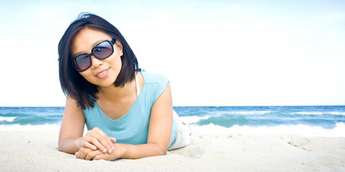 Girl on the beach with sunglasses