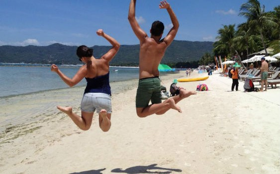Couple jumping on the beach in Thailand