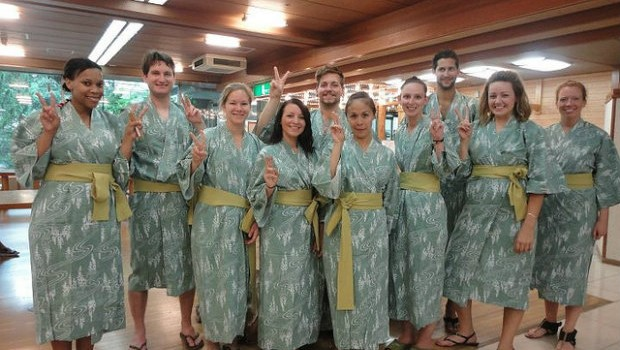 Group makes peace signs in Onsen Robes in Japan