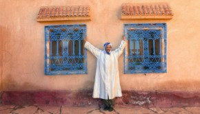 Man cheering by windows in Morocco