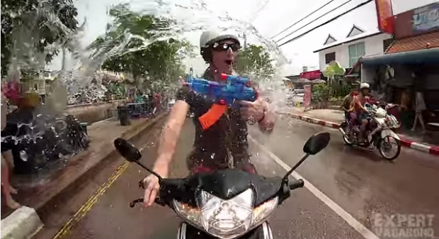 Songkran Thailand water fight on a moped