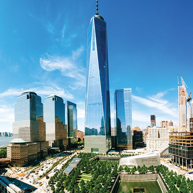 view-of-freedom tower-and-grounds-new-york-city-against-beautiful-blue-sky