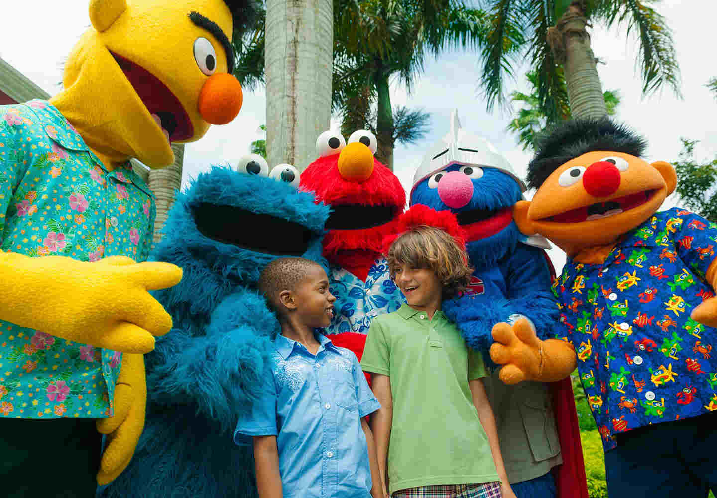 sesame street characters with kids at beaches resort in jamaica