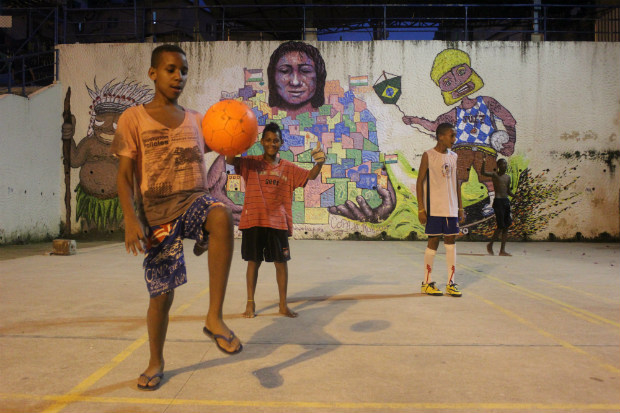 children playing football in Rio Brazil