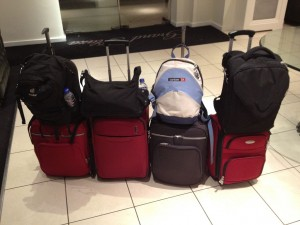 4 pieces of luggage at the airport