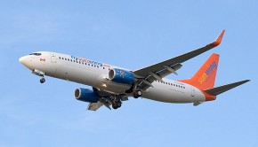 Sunwing airplane in the sky