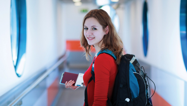 young woman boarding plane