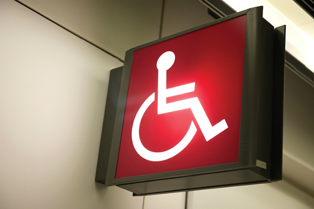 Accessible travel wheelchair sign