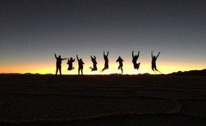 People jumping in Bolivia at sunset