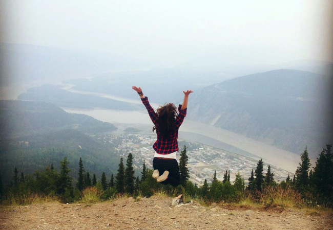 jumping for joy in Dawson Yukon