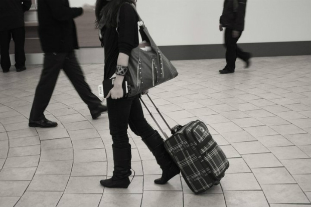 woman with a carry on in the airport