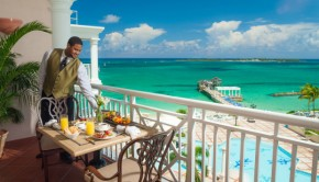 butler serving breakfast on balcony Sandals Royal Bahamian