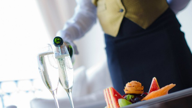 sandals butler pouring champagne