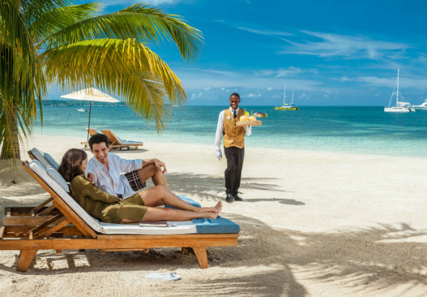 sandals butler serving couple on beach