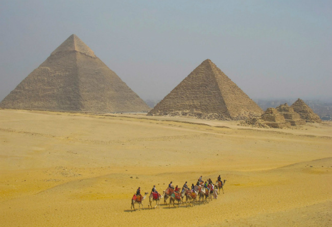 camel riding at pyramids of giza in egypt