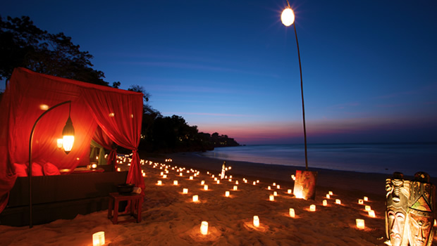 bali beach with candles and canopy