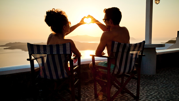 couple heart in greece at sunset