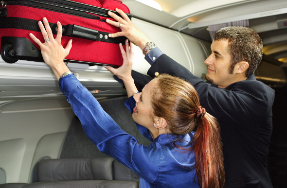 overhead luggage red suitcase
