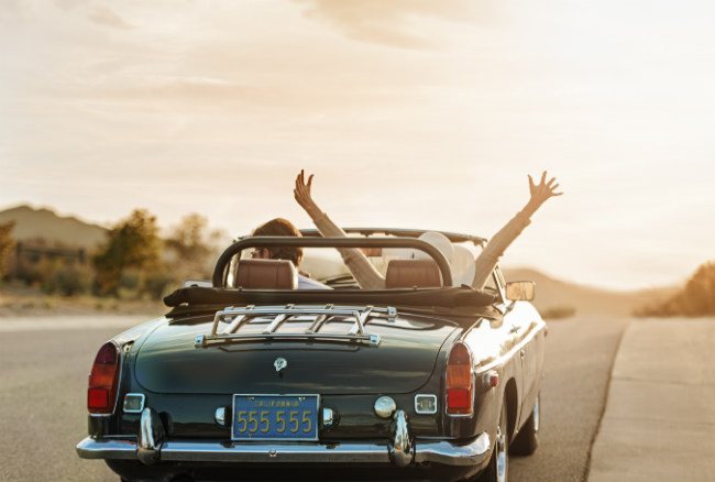 couple in car on a road trip