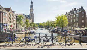 bicycles along a canal in amsterdam