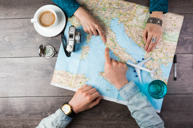 map and hands_travel planning_istock
