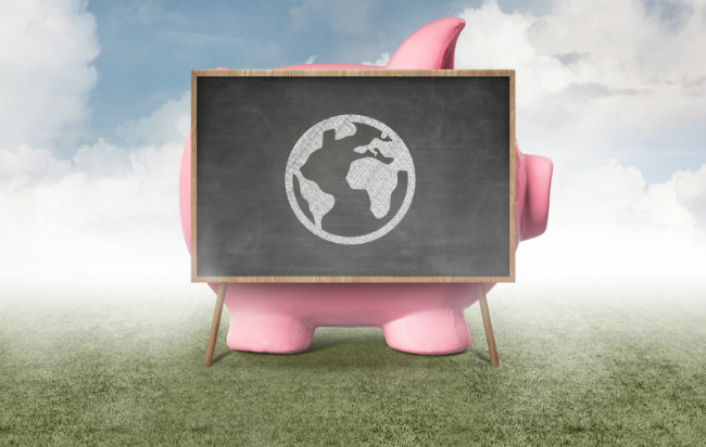 Piggy bank with chalk board in front of it