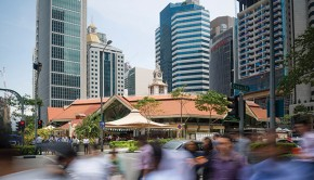 People rushing by at the Telok Ayer Market, Singapore
