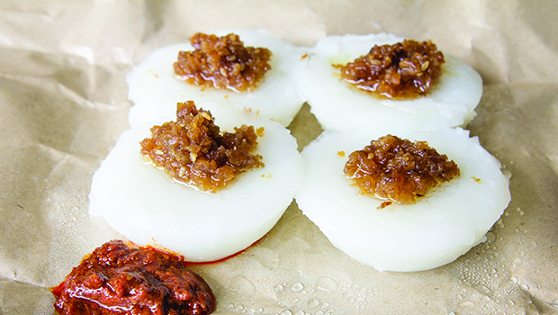 Singapore Chwee Kueh Steamed Water Rice Cake with Preserved Turnip and Chili Paste Closeup