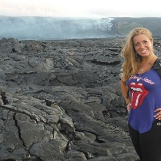 tours expert standing by molten lava