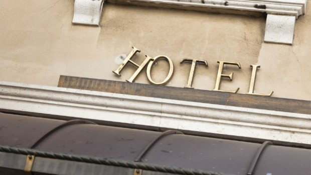 crooked hotel sign