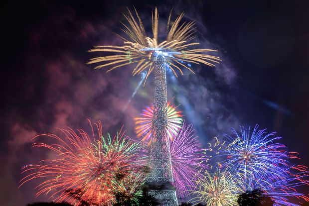 colourful fireworks display around the eiffel tower in paris france
