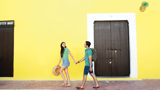 couple in front of a bright yellow wall