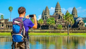 man taking a photo of a temple in angkor wat cambodia