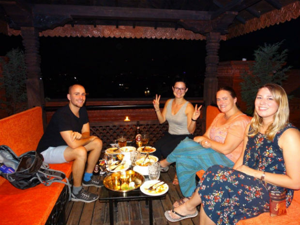 group having dinner in nepal with g adventures