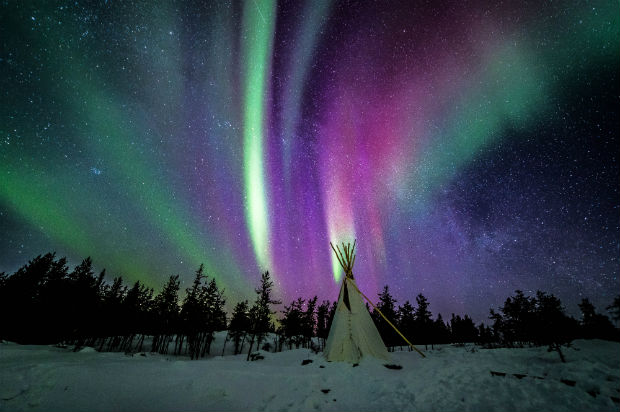 tipi underneath northern lights