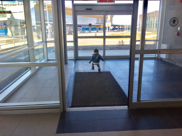 cute baby at airport toddler running