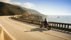 motorcyclist on bridge in big sur