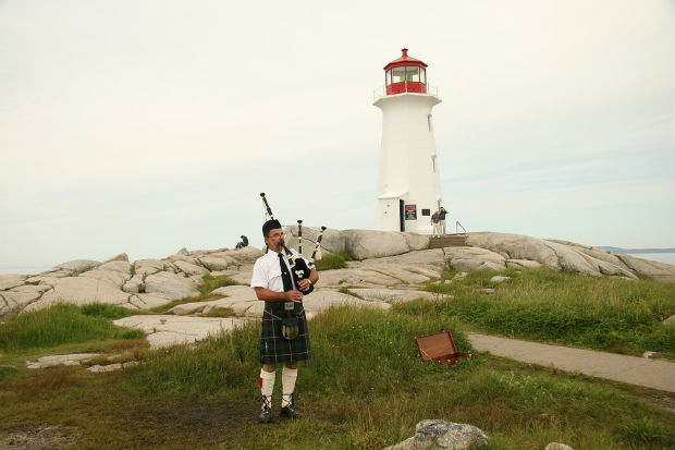 scottish piper bagpipes nova scotia tourism lighthouse canada attractions