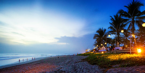beach at sunset in seminyak bali indonesia