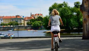 girl on bicycle in prague