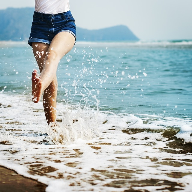 splashing in the ocean on the beach pure joy