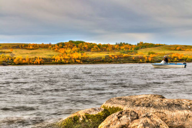 fishing in saskatchewan fall colours lone fisherman