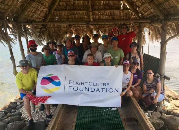 flight centre foundation banner with flighties employees giving back in hawaii